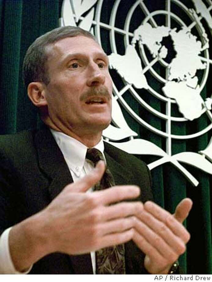 United Nations deputy chief arms inspector Charles Duelfer speaks to reporters at the noon briefing at the U.N. Friday Jan. 16, 1998. U.N. officials said they decided to withdraw Scott Ritter, the American leader and his inspection team after it became clear that it could not work. We are not being pressured, Duelfer said late Thursday because they had left according to their previous schedule. (AP Photo/Richard Drew) Photo: RICHARD DREW