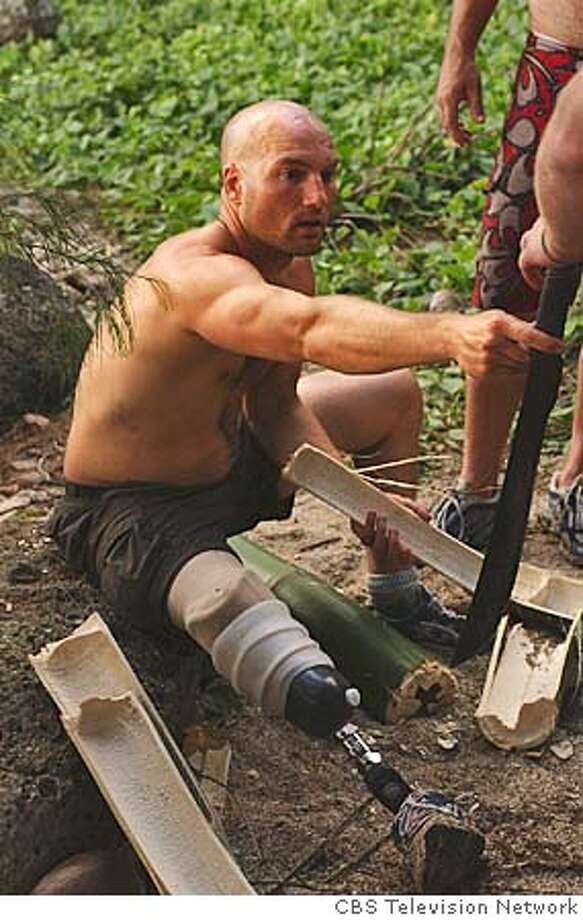 caption: Chad Crittenden, during the first episode of SURVIVOR: VANUATU Islands of Fire, premiering Thursday, Sept 16 8:00-9:00pm on the CBS Television Network. Photo: Monty Brinton/CBS Ran on: 09-18-2004  Chad Crittenden in the first episode of &quo;Survivor: Vanuatu -- Islands of Fire.&quo; Crittenden, a 35-year-old Oakland teacher, is one of 18 contestants. He lost his lower right leg to cancer a couple of years ago. Photo: MONTY BRINTON