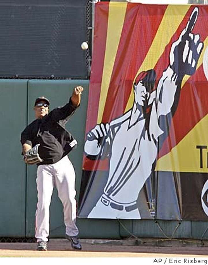 San Francisco Giants' Barry Bonds throws from center field after catching fly balls at Scottsdale Stadium during spring training in Scottsdale, Ariz., Wednesday March 9, 2005. Bonds, who is continuing his rehabilitation following knee surgery, took part in fielding drills for the first time this spring.(AP Photo/Eric Risberg) Photo: ERIC RISBERG