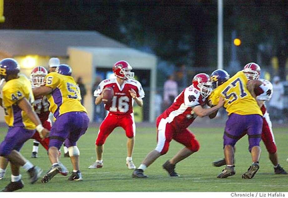 Burlingame High School plays football against Riordan High School at Burlingame. Quarterback Drew Shiller during the start of the second quarter. Shot on 9/17/04 in Burlingame. LIZ HAFALIA / The Chronicle Photo: LIZ HAFALIA
