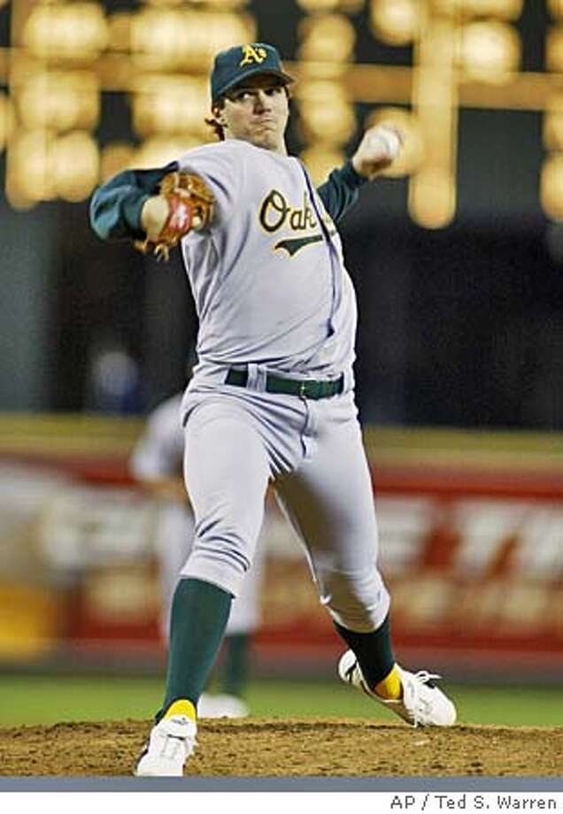 Oakland Athletics starting pitcher Barry Zito throws against the Seattle Mariners in the third inning Friday, Sept. 17, 2004 at Safeco Field in Seattle. (AP Photo/Ted S. Warren) Photo: TED S. WARREN