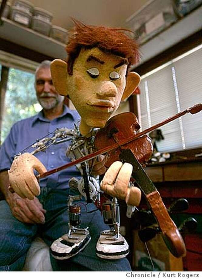 Bob Hartman shows off The Violinist a new puppet he is working on . Bob Hartman with his hand puppet's in his Tiburon workshop. 8/27/04 in San Francisco,CA.  Kurt Rogers/The Chronicle Photo: Kurt Rogers