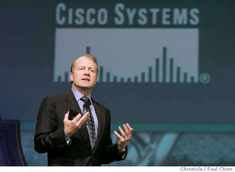John Chambers, president and CEO of Cisco Systems, delivers the keynote address during Tuesday morning's session. The second day of the RSA Conference on information security on 2/16/05 in San Francisco, CA.  PAUL CHINN/The Chronicle Photo: PAUL CHINN