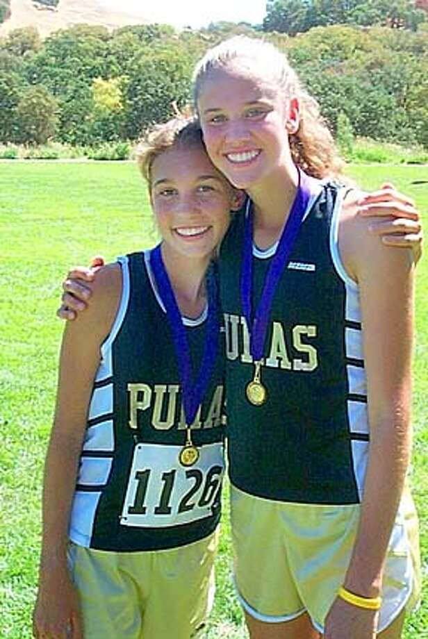 Maria Carrillo cross country teammates Leanne Fogg (1126) and Amy Robinson (1131) after placing ninth and eighth, respectively at the 210-person Ed Sias Invitational in Martinez on Saturday