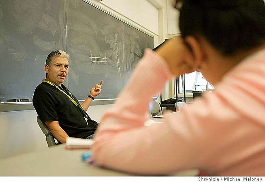 Anthony Perez teaches a Interpersonal Communications class.  Canada College teacher Anthony Perez recognizes the challenges many of his college students face growing up in tough neighborhoods of the Peninsula. The 41-year-old former Mission District gang member started teaching this August at Canada College and hopes to positively influence his students like teachers and employers have him.  Photo by Michael Maloney / San Francisco Chronicle Photo: Michael Maloney