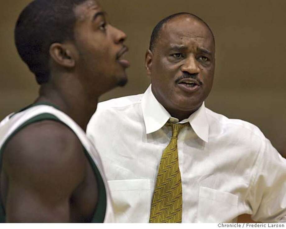 USF_0174_fl.jpg USF basketball coach Jessie Evans with Sinqua Walls during picture days for USF BB at the Memorial Gymnasium, USF campus. 10/15/04 San Francisco CA Frederic Larson The San Francisco Chronicle Ran on: 10-16-2004  Jessie Evans, talking with Sinqua Walls on Friday, won a national championship with Lute Olson at Arizona. Ran on: 01-09-2005  USF coach Jessie Evans knows his team will be against the odds when the Dons take on Pepperdine in Malibu. Photo: Frederic Larson