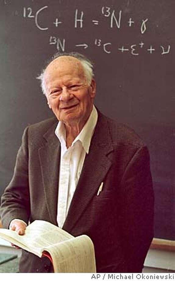 "**FILE** Cornell University Professor Hans A. Bethe is pictured in his campus office in Ithaca, N.Y., Dec. 19, 1996. Written on the blackboard is Bethe's famous ""Carbon Cycle"" equation for nuclear energy generation in stars. Bethe, who played a pivotal role in designing the first atomic bomb and won a belated Nobel Prize in physics in 1967 for figuring out how the sun and stars generate energy, died at his home Sunday, Cornell University said Monday, March 7, 2005. He was 98. (AP Photo/Michael Okoniewski) FILE PHOTO FROM DEC. 19, 1996 Photo: MICHAEL OKONIEWSKI"
