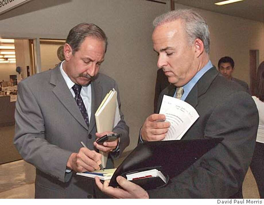 Mark Geragos (left) and Patrick Harris, the defense team for Scott Peterson look over notes as they wait for the elevator after returning from a lunch break at the San Mateo County Courthouse in Redwood City, California for the ongoing trial of Scott Peterson on Wednesday September 15, 2004. Peterson is the Modesto man who is charged with the murders of his wife Laci and their unborn son and could face the death penalty if convicted. (Photo by David Paul Morris,pool) Photo: DAVID PAUL MORRIS
