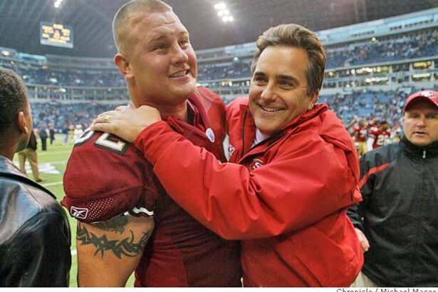 49ERS13-C-08DEC02-SP-MAC San Francisco 62- Jeremy Newberry and head coach Steve Mariucci celebrate the 49ersw win at the end of the game. San Francsico Forty Niners v. Dallas Cowboys at Texas Stadium, Irving, Texas, Dec. 8, 2002. by Michael Macor/The Chronicle