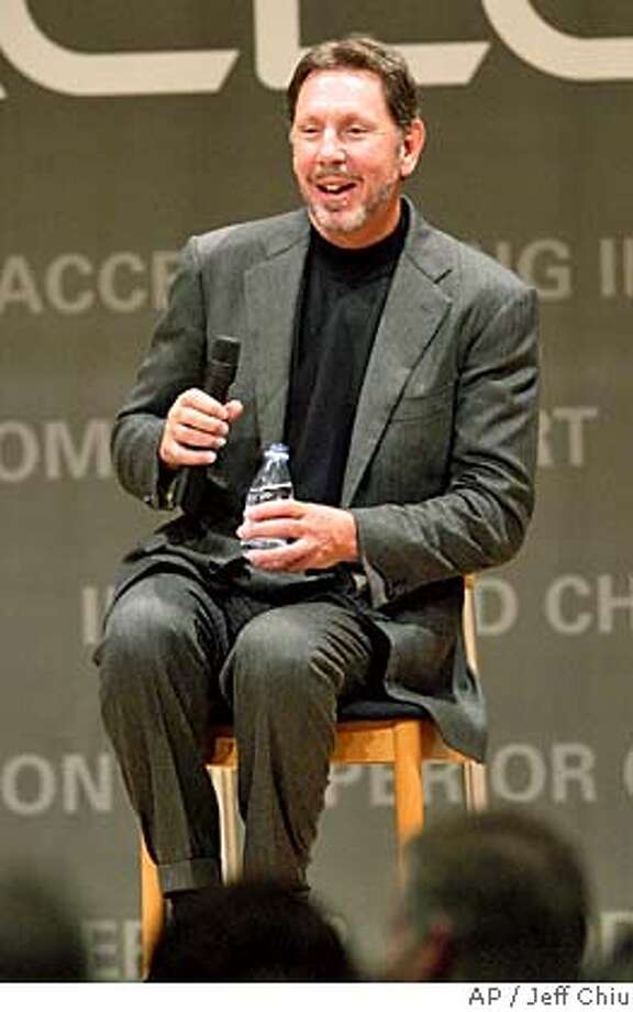 Oracle Corp. CEO Larry Ellison laughs while taking questions at a presentation to detail its plans for PeopleSoft, which has just been acquired for $10.3 billion, at Oracle Corporate Offices in Redwood Shores, Calif., on Tuesday, Jan. 18, 2005. (AP Photo/Jeff Chiu) Ran on: 01-27-2005  Ellison Ran on: 01-27-2005  A homeless counter works on census in Contra Costa County. *{A7D6EE6A-90CF-4275-ADD1-2F678039FC1C}* Photo: JEFF CHIU