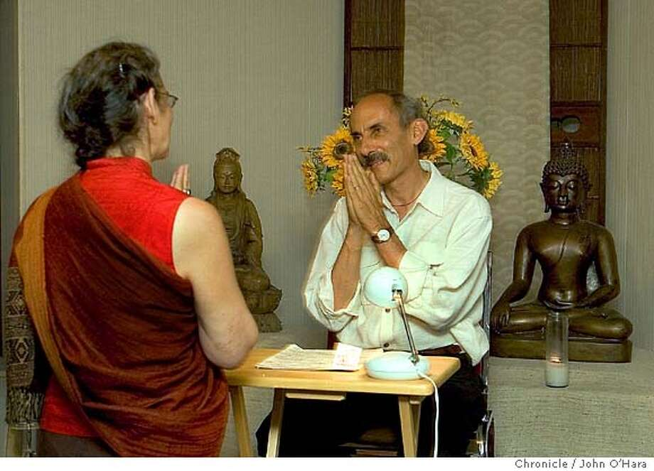 Spirit Rock Meditation Center. 5000 Sir Francis Drake Blvd. Woodacre, CA  Cynthia Williams of Mill Valley, speaks with, Jack Kornfield durning a brake.  Jack Kornfield, directsw a meditation class at the center  Photo/John O'hara Photo: John O'Hara
