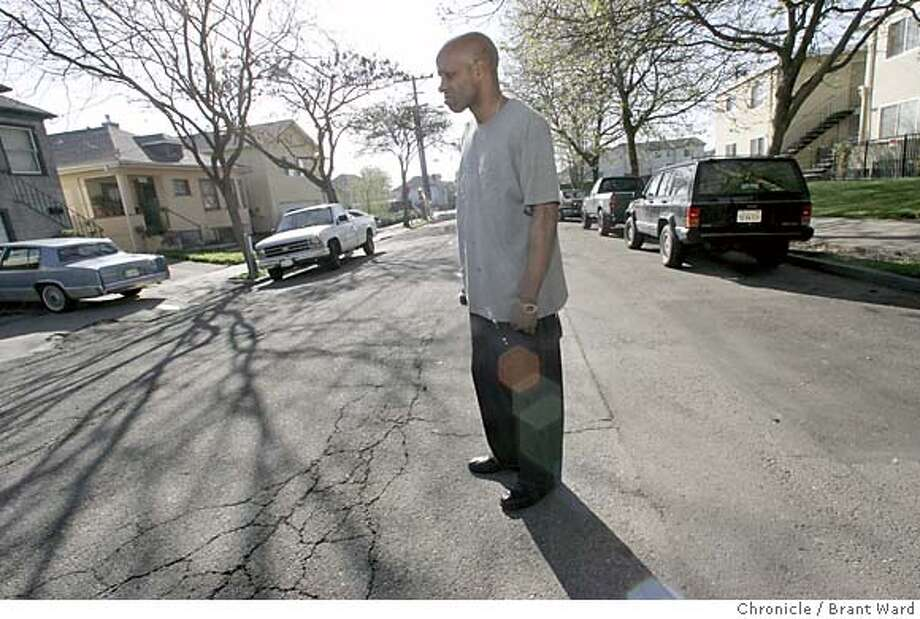 Kevin Thomas stands in the middle of 59th Street where he lives, near Shattuck. The drug dealers leave him alone because he is a Tae Kwon Do instructor...he once tried to teach the kids that deal, but it didn't take. He is friends with Patrick McCullough, who shot the youth recently. Oakland's 59th Street neighborhood is going through changes. An influx of homebuyers has changed the demographics and increased the vigilance against drug dealing.  By Brant Ward/SF Chronicle MANDATORY CREDIT FOR PHOTOG AND SF CHRONICLE/ -MAGS OUT Photo: Brant Ward