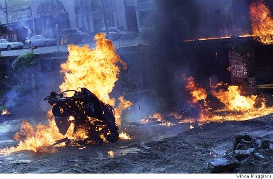 EXPLOSION/C/11FEB98/CD/VM = The film crew on Nash Bridges exploded a car at Jackson and Kearny SF for the TV show Nash Bridges. by Vince Maggiora Photo: VINCE MAGGIORA