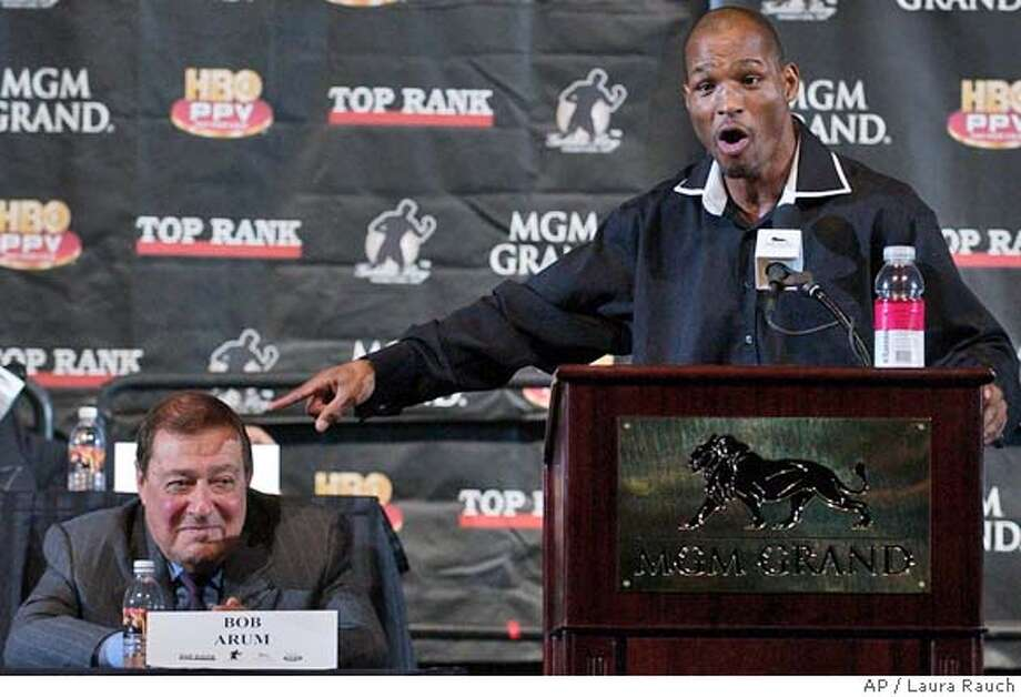 Bernard Hopkins points to his opponent as promoter Bob Arum listens during a press conference in Las Vegas on Wednesday, Sept. 15, 2004 for the upcoming undisputed middleweight title fight between Hopkins and Oscar De La Hoya on Sept. 18. (AP Photo/Laura Rauch) Photo: LAURA RAUCH