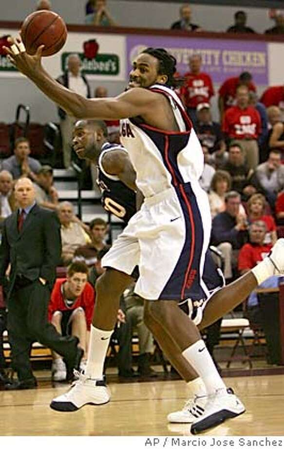 Gonzaga's Ronny Turiaf, right, grabs a rebound in front of Saint Mary's Frederic Adjiwanou ,left, in the first half of the West Coast Conference tournament championship game in Santa Clara, Calif. on Monday, March 7, 2005. (AP Photo/Marcio Jose Sanchez) Photo: MARCIO JOSE SANCHEZ