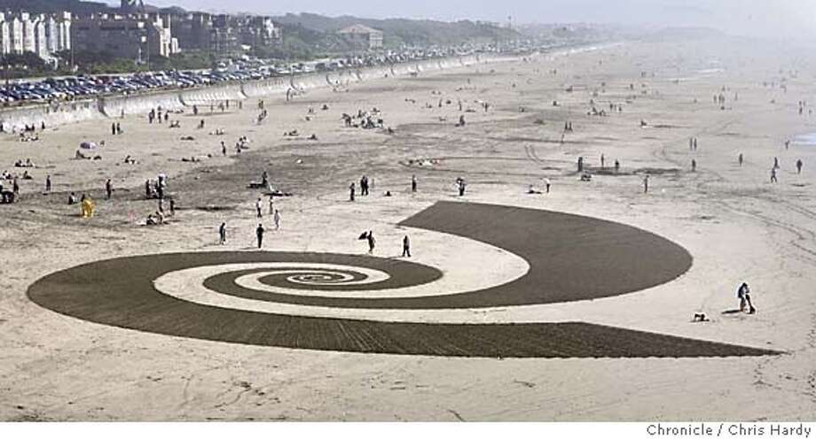 Jim Denevan raking a big drawing into the sand at Ocean Beach  in San Francisco  3/6/05 Chris Hardy / San Francisco Chronicle Photo: Chris Hardy