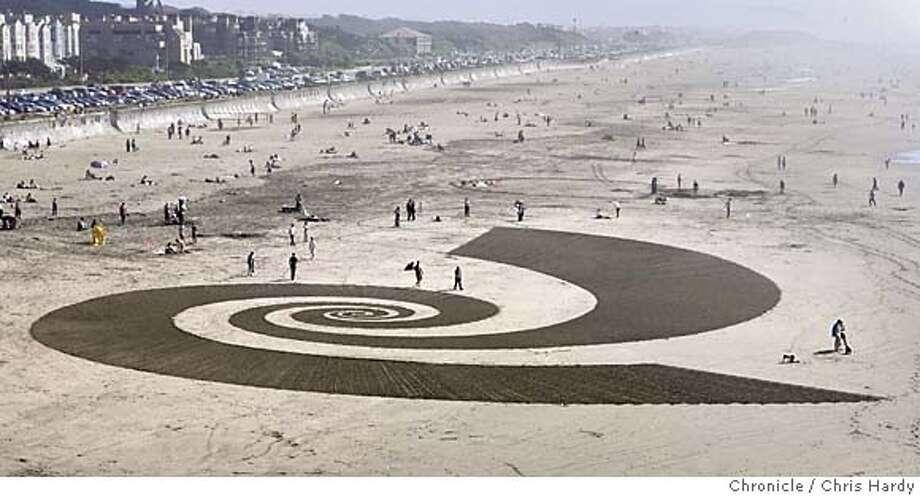 Jim Denevan raking a big drawing into the sand at Ocean Beach  in San Francisco  3/6/05 Chris Hardy / San Francisco Chronicle Photo: Chris Hardy