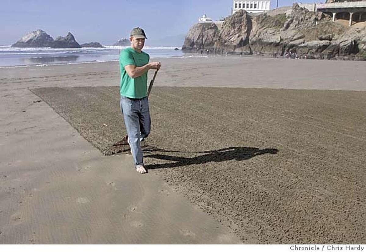 Jim Denevan raking a big drawing into the sand at Ocean Beach in San Francisco 3/6/05 Chris Hardy / San Francisco Chronicle