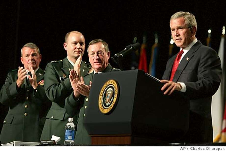 President Bush, right, is applauded by Maj. Gen. Gus Hargett, center, Col. Al Faber, second left, and Brig. Gen. Robert Taylor, left, as he speaks at the General Conference of the National Guard Association at the Las Vegas Convention Center in Las Vegas, Nev., Tuesday, Sept. 14, 2004. (AP Photo/Charles Dharapak) Photo: CHARLES DHARAPAK