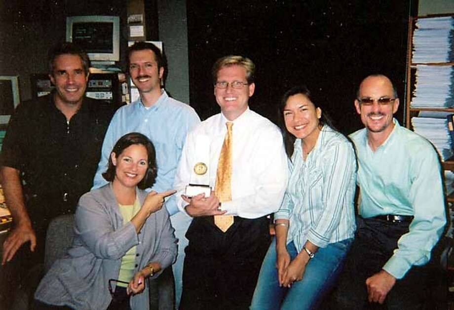 Bill Lueth of KDFC radio in center of airstaff clutching 2004 NAB Award for 'Best Classical Station' in the U.S. (from left, Hoyt Smith, Rik Malone, Dianne Nicolini, Bill Lueth, Linda Cassidy, John Evans).