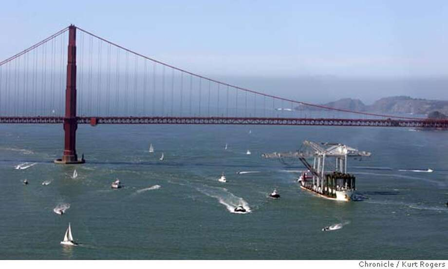 The Crans heading for the Port of Oakland passed under the Golden Gate bridge. Huge cranes came under the Golden Gate and Bay Bridges this morning on their way to the port of oakland. 3/5/05 in San Francisco,CA.  KURT ROGERS/THE CHRONICLE Photo: KURT ROGERS