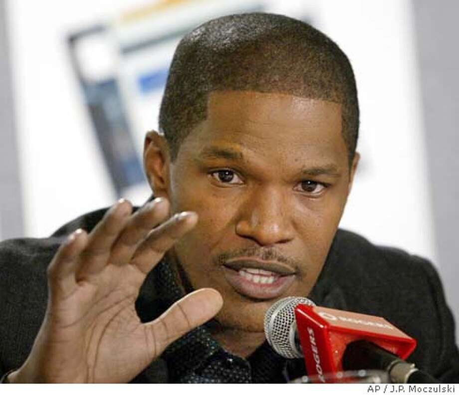 "Actor Jamie Foxx gestures during a news conference discussing his new film ""Ray"" at the Toronto International Film Festival in Toronto on Sunday Sept. 12, 2004. (AP Photo/CP, J.P. Moczulski) Photo: J.P. MOCZULSKI"