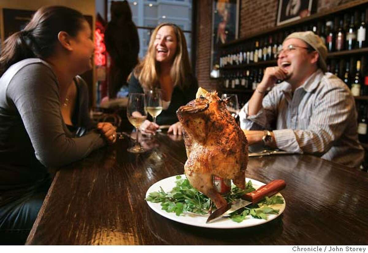 The Rocky Jr. Beer Can Chicken. In the background, L to R; Pamela Hugo; Shelley Biven and sergio Valinzuela. Review of the restaurant Bounty Hunter in Napa. John Storey Napa, CA. 2/10/05 Napa, CA John Storey/The Chronicle