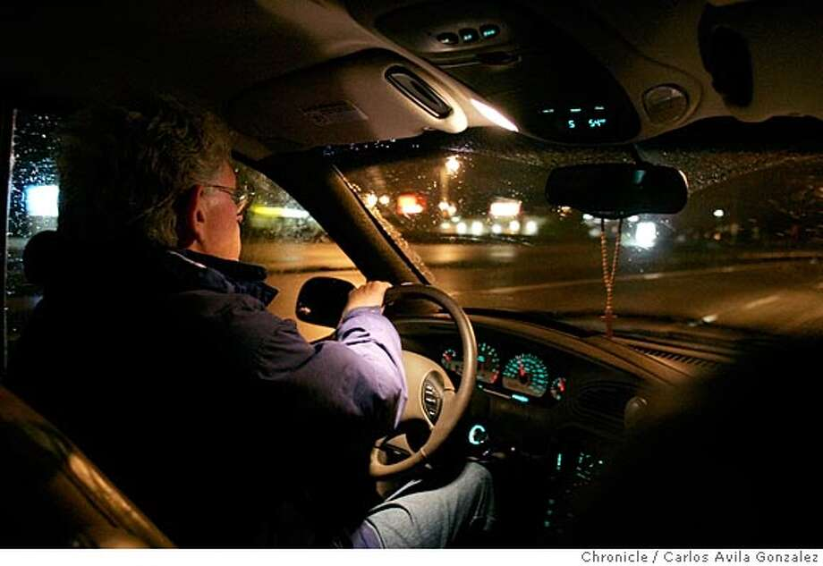 "Mike Niece drives through the empty streets of Half Moon Bay looking for the homeless, on Tuesday night, January 25, 2005. Mike and and his wife, Kathy Niece, have set up a refuge in their two-story Half Moon Bay house for some of San Mateo County�s coastal homeless community, many of whom are Mexican immigrants who came to California for jobs as field hands. On the coastal Peninsula, many of the homeless immigrants work in the floral, fruit and vegetable industries. Niece, 62, himself a cancer survivor and a registered nurse, has along with his wife given up most of his material possessions in keeping with the Catholic Worker tradition. In 2000, the Nieces opened Magdalene House, working long days gathering food and clothing to give away twice a week from their garage. Currently, they house two single, homeless women in an upstairs apartment above their home. ""Walking with the poor is what we do,"" Mike Niece said. ""This is more than a job. This is a calling. It�s what our faith has lead us to do.""  Photo by Carlos Avila Gonzalez / The San Francisco Chronicle  Photo taken on 1/26/05 in Half Moon Bay, CA. Photo: Carlos Avila Gonzalez"