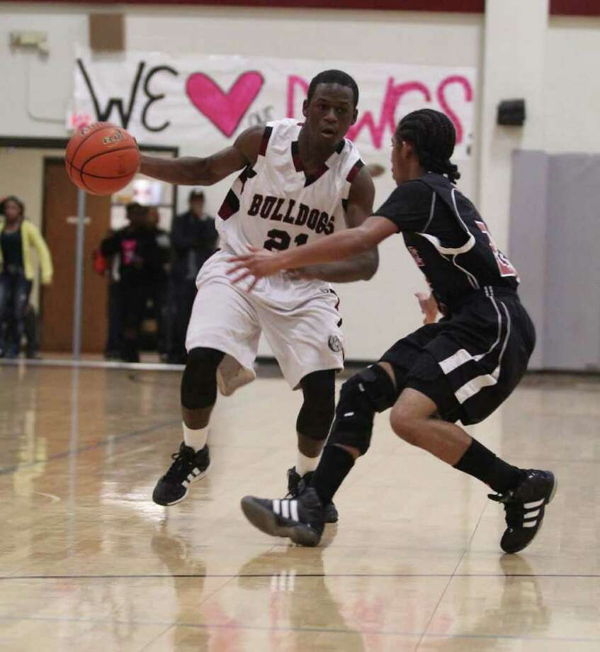 Demarcus Collins dribbles around a Kirbyville defender. Photo: Jason Dunn