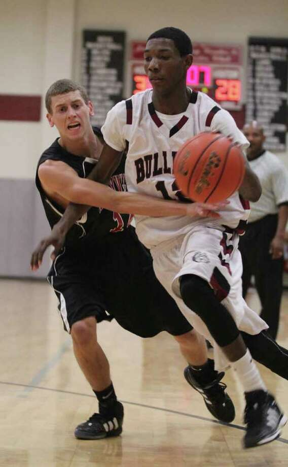 Crosby Jackson dribbles away from a Kirbyville defender during Tuesday's win over the Wildcats. Photo: Jason Dunn