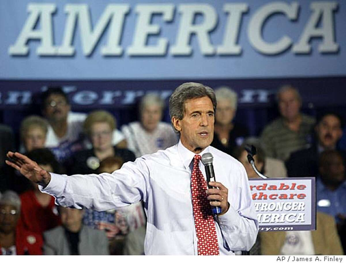 Democratic presidential candidate John Kerry gestures while discussing health care and the rising cost of prescription drugs during a rally in Affton, MO., Friday, Sept. 10, 2004. (AP Photo/James A. Finley)