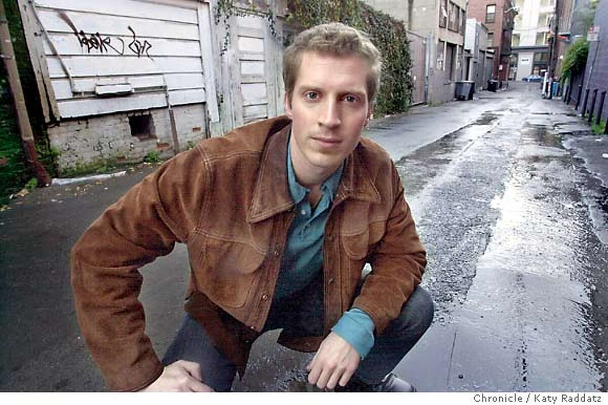 """Andrew Sean Greer is a brilliant new author based in San Francisco. His novel, """"The Confessions of Max Tivoli"""" just won a rave review from John Updike in the New Yorker. SHOWN: Greer in a South Park alley, where the hero of his novel is raised. Shoot date is 1/27/04; writer is Edward Guthmann. Katy Raddatz / The Chronicle"""