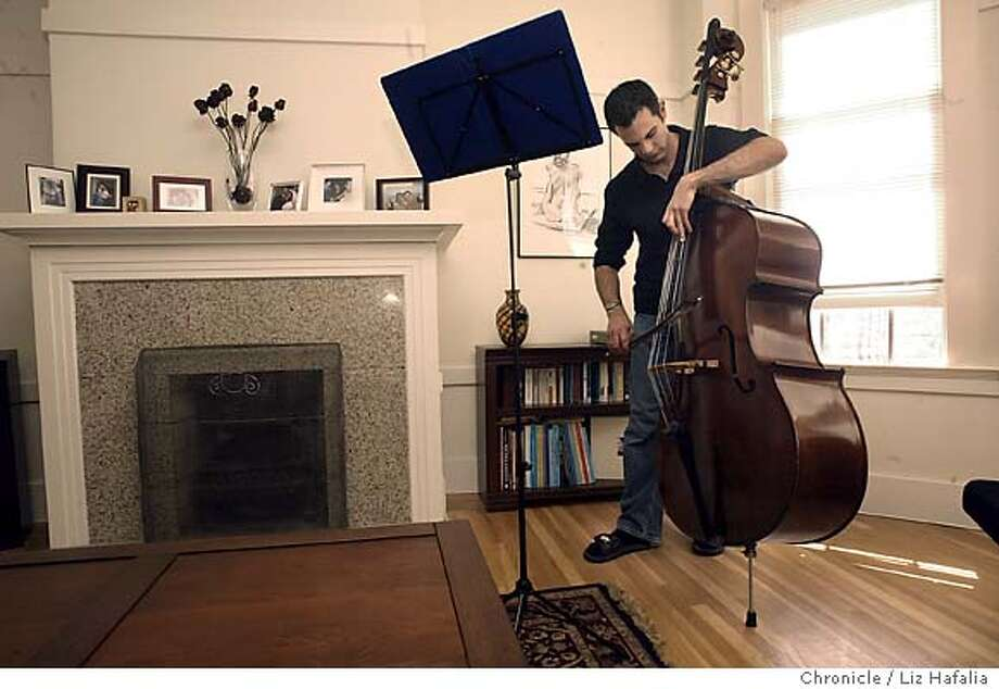 San Francisco Symphony principal bassist Scott Pingel is making his debut today. He's at home with his bass. Shot on 9/8/04 in San Francisco. LIZ HAFALIA / The Chronicle Photo: LIZ HAFALIA