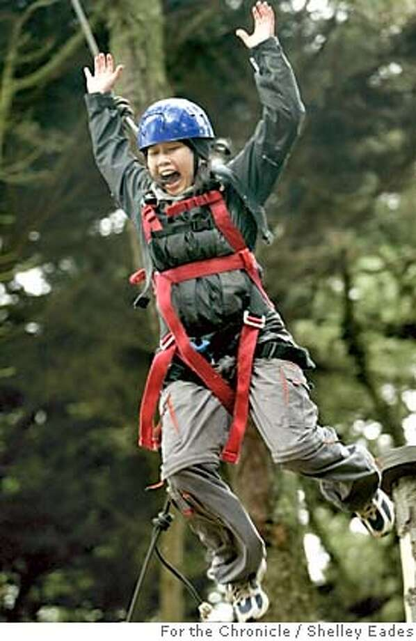 """OUTKIDS_004_SME.JPG  Environmental Traveling Companions (ETC) gives a """"leadership training"""" ropes course at Fort Miley in San Francisco designed to help participants like Luisa Tsang, 16, of San Francisco, not only appreciate the outdoors but to respect nature as well. Photo taken on 07/26/04 in San Francisco, Ca.  Photo by Shelley Eades/The San Francisco Chronicle MANDATORY CREDIT FOR PHOTOG AND SF CHRONICLE/ -MAGS OUT Photo: Shelley Eades"""