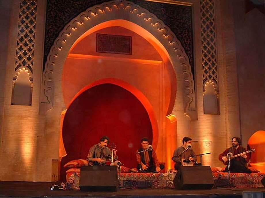Kayhan Kalhor is on the far left, Mohammad Reza Shajarian is to his right, Homayoun Shajarian is the 2nd to the right, and Hossein Alizadeh is on the far right. Masters of Persian Music Photo: Cindy Byram PR