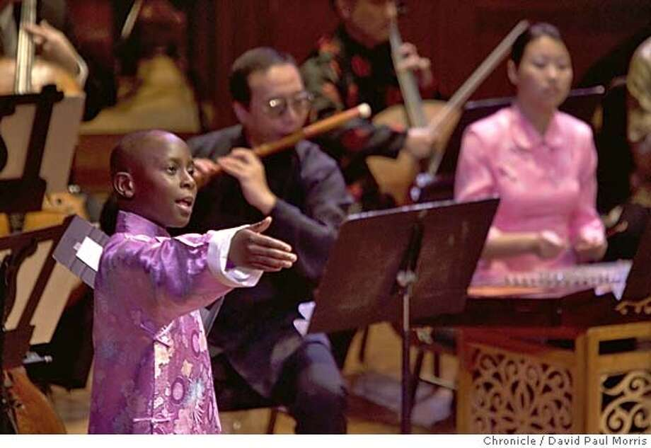 San Francisco CA-FEBRUARY 5: Tyler Thompson, 9, of Oakland sings Chinese opera during a Chinese New Year concert with the San Francisco Symphony at Davies Symphony Hall in San Francisco, California on Saturday February 5, 2005. He is considered something of a virtuoso and is attracting international attention. Photo by David Paul Morris / The Chronicle Photo: David Paul Morris