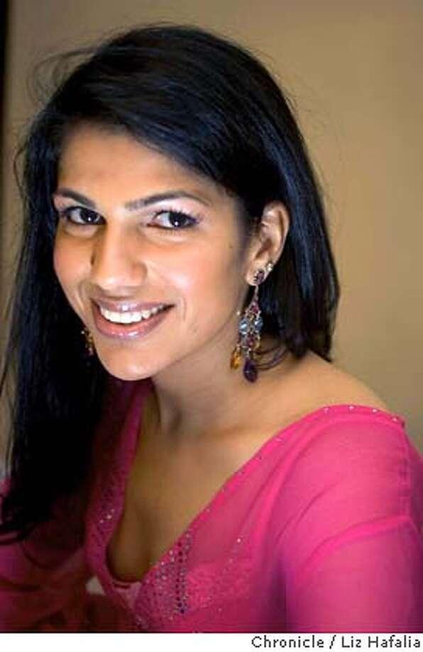 Isharya founder RadhikaTandon wears her Lyra diamond, blue topaz and amethyst earrings ($3,280). Chronicle photo by Liz Hafalia