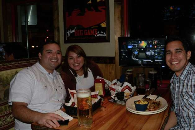 Xavier Pena (cq) (from left), Veronica Zavala and David Montemayor get their eats and drinks at Twin Peaks on January 21, 2012. Robin Johnson