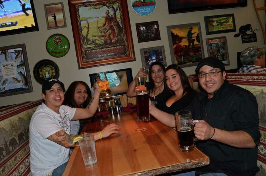 Anthony Gomez (from left), Lucy Henderson, MaryAnn Ayala (cq), Joanie Henderson and Mike Olivares drink it up for the Spurs game at Twin Peaks on January 21, 2012. Robin Johnson