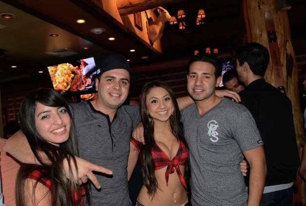 Lauren Marie Ruiz (from left), Joe Guerrera (cq), Eloy Gonzalez (cq) and Samantha Guadarrama (cq) chill barside at Twin Peaks on January 21, 2012. Robin Johnson