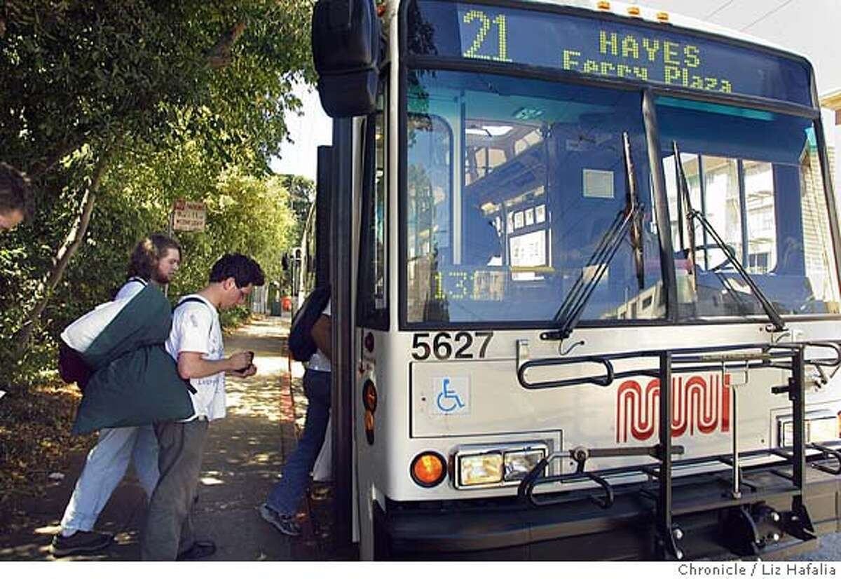 left top right--Zhenya Warshavsky (with pillow) and Nate Maas catching bus 21 to the Ferry building with two other friends. These four college students are planning to ride every single MUNI line in San Francisco from start to finsh over the Labor Day weekend. Shot on 9/5/04 in San Francisco. LIZ HAFALIA / The Chronicle