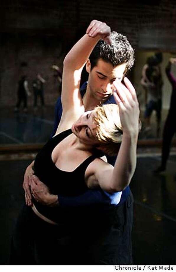 ODC27_084_KW.jpg  On 1/24/05 in San Francisco Andrea Flores and her husband Justin, who are both members of the ODC dance company dance together during rehearsal monday afternoon. Kat Wade / The Chronicle MANDATORY CREDIT FOR PHOTOG AND SF CHRONICLE/ -MAGS OUT Photo: Kat Wade