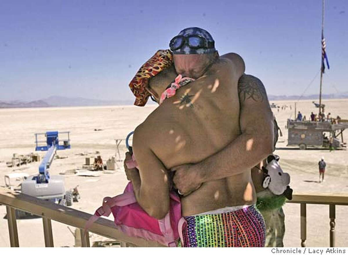 """Chris Verdugo and Gene Hubert cry as they comfort each other in the Temple of Star at Burning Man , Sat. Sept. 4, 2004, in the Black Rock Desert. """" This place will suck all the negative energy out of you if youi just let it"""", said Hubert. of People gather at Black Rock desert for the 18th annual Burning Man celebration, Saturday Sept.4, 2004, . LACY ATKINS/ The Chronicle"""