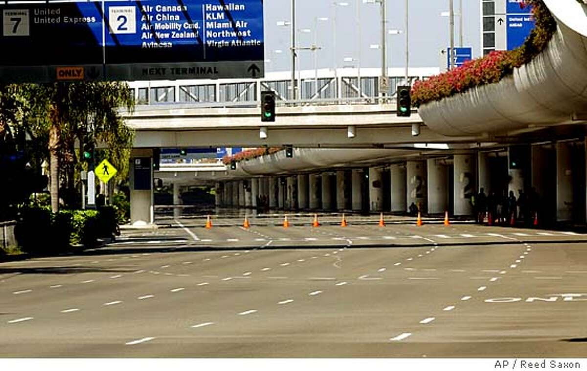 The main ring road at Los Angeles International Airport is deserted during the complete shutdown of the airport following two incidents at two separate terminals Saturday morning, Sept. 4, 2004. (AP Photo/Reed Saxon)