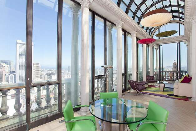 The penthouse's sunroom offers impressive views of the city. Photo: Jeff Warrin, Redgate Photography