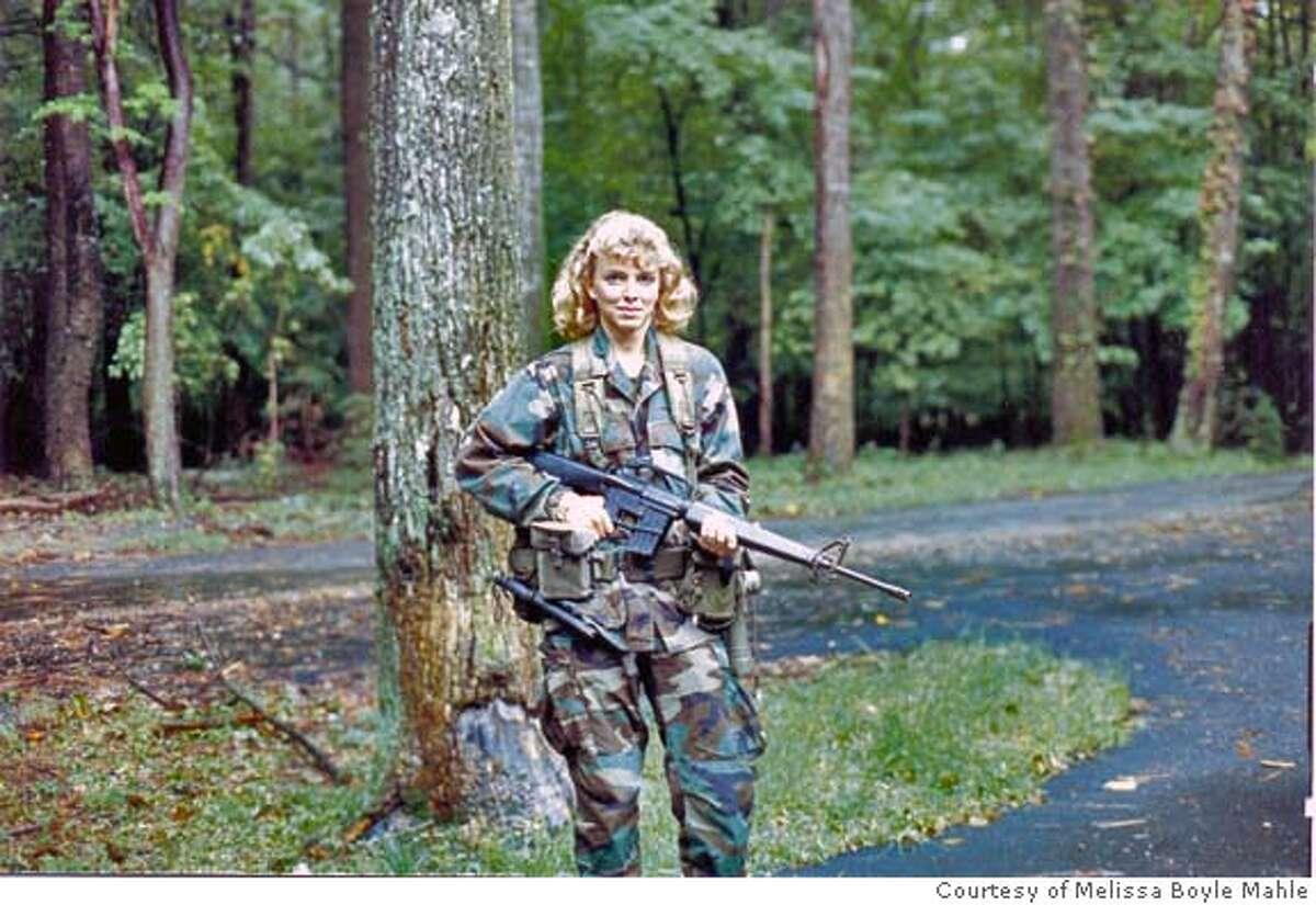 Photo of Melissa Boyle Mahle at paramilitary training.
