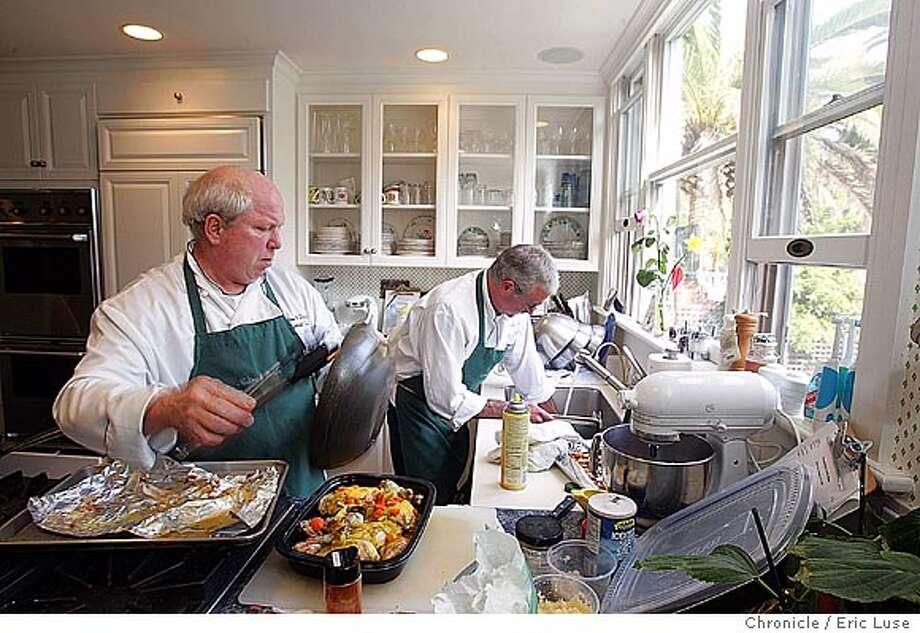 pnchefs_0021_el.jpg  Dane Mechlin, (left) and Stan Timbrook (right) preparing meals at a client's home in Palo Alto.  Big City Chefs, a company out of South San Francisco, and other such companies that allow people to buy a gourmet chef for a day. The chef comes to your house, goes shopping with you to buy ingredients for your meal, then cooks for you, in your kitchen, with your tools. in this assignment, the chef will be preparing a meal (meals?) for a client, who is ok about us being there, but does not want to be identified. Event on 2/16/05 in Palo Alto. Eric Luse / The Chronicle Photo: Eric Luse