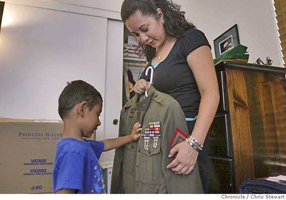 Event on 8/31/04 in Santa Maria  Stacy Menusa, widow of Gunnery Sgt. Joseph Menusa with their son Joshua, 4 1/2. One of many portraits of Northern California families who have lost a military son or daughter in the Middle East.  Chris Stewart / The Chronicle Photo: Chris Stewart