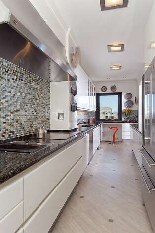 Another view of the kitchen, which features a contemporary tile backsplash. Photo: Jeff Warrin, Redgate Photography