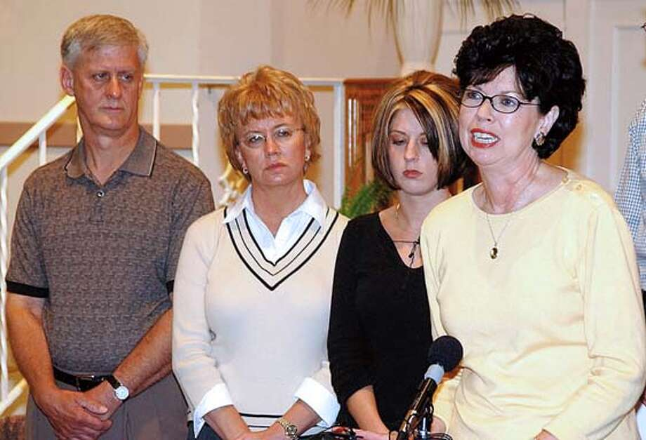 Delores Allen, mother of the late Jason Allen of Zeeland, Michigan, speaks about her son during a press conference at Immanuel Baptist Church in Holland, Michigan on Saturday, August 28, 2004. Jason's father Robert Allen, left, Lindsay Cutshall's mother Kathy Cutshall, and Jason's sister Elizabeth Westra listen in the background.